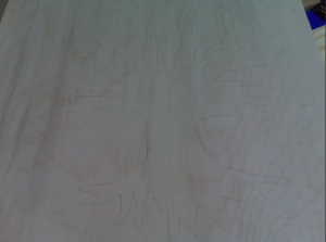 Tracing tree design onto wood by