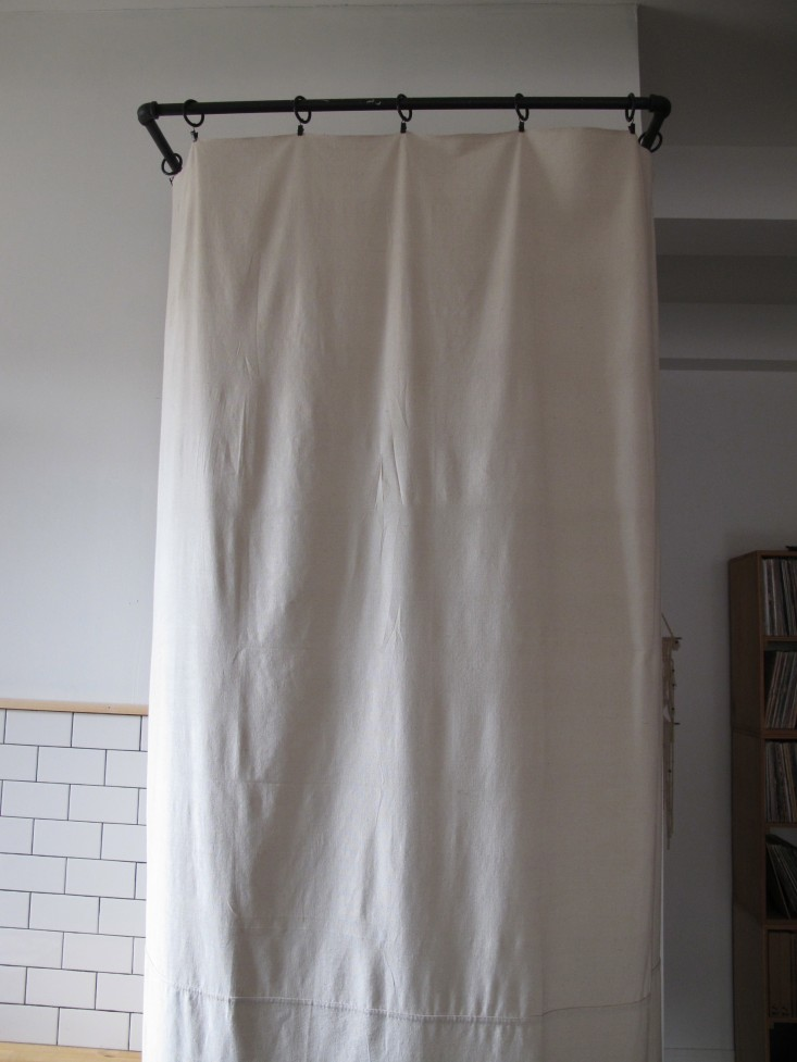 Myles-Tipley-DIY-curtained-laundry-closet-Remodelista-2